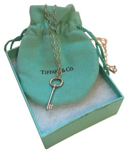 Tiffany & Co. Oval key sterling silver pendant with chain