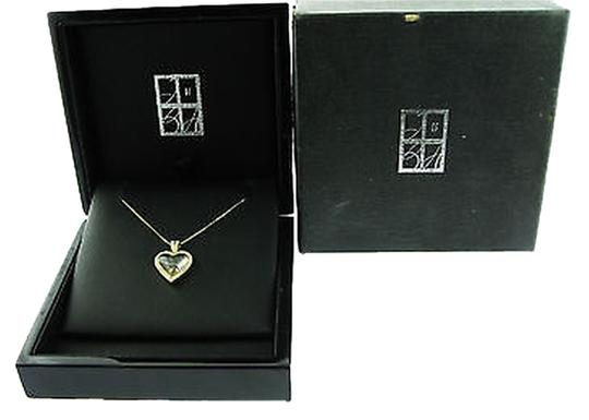 Preload https://item1.tradesy.com/images/stessier-14k-yellow-gold-floating-heart-pendant-necklace-2069460-0-0.jpg?width=440&height=440