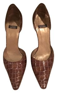 Stuart Weitzman Light to medium brown patent. Pumps