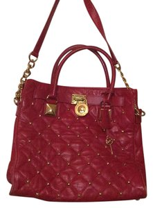 Michael Kors Tote in red with gold studs