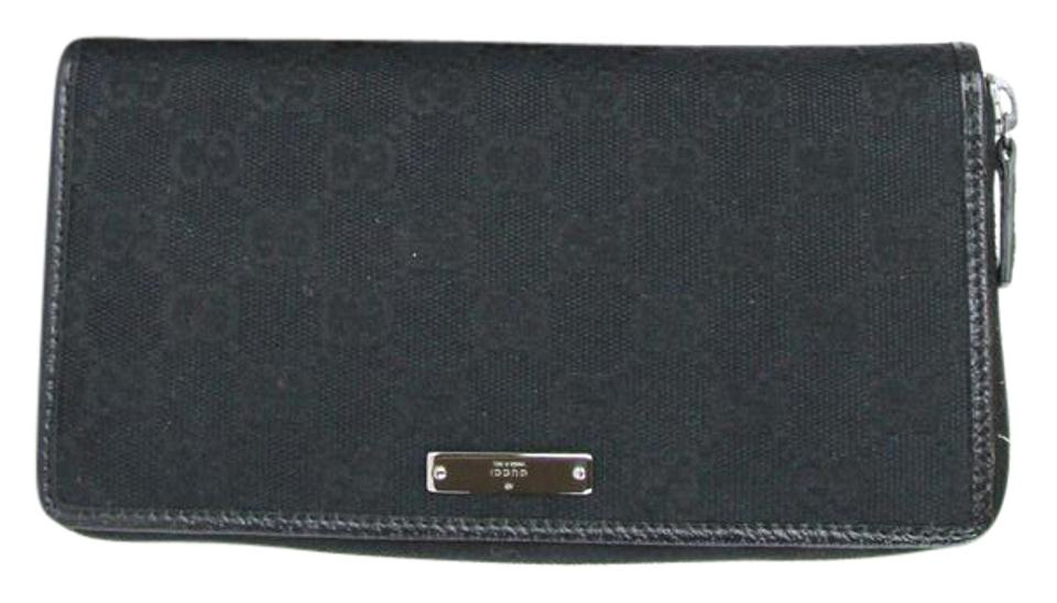 a0a1c6f6114 Gucci Gg Zip Around Wallet 112724 Black Canvas Clutch - Tradesy