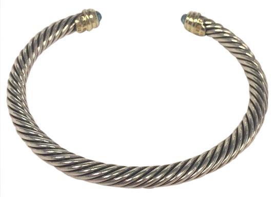 Preload https://img-static.tradesy.com/item/20708720/david-yurman-silver-with-14k-gold-end-caps-with-blue-topaz-classic-cable-style-number-b03934-s4abt-b-0-1-540-540.jpg