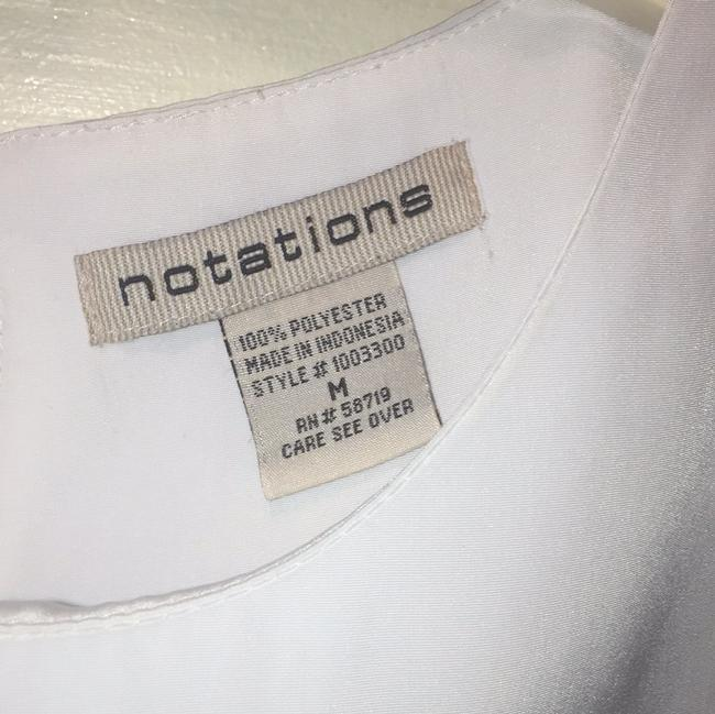 Notations Top White Image 1