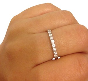 Tiffany & Co. Shared-setting band ring in platinum