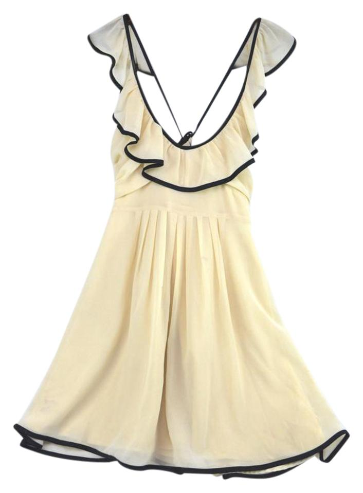 e509d71ffda Forever 21 Ivory Ruffled with Criss Cross Back Short Cocktail Dress ...
