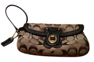Coach Wristlet in Brown and black fabric with gold metal