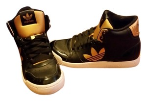 adidas black, white and gold Athletic