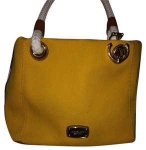 Michael Kors Satchel in brown leather with cream rope handles , color brick yellow undertones.
