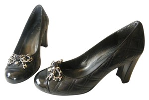 Stuart Weitzman Quilted Leather Chain Bow Black Pumps