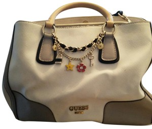 Guess Satchel in White with black and gray trim.