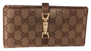 Gucci Fabric and leather
