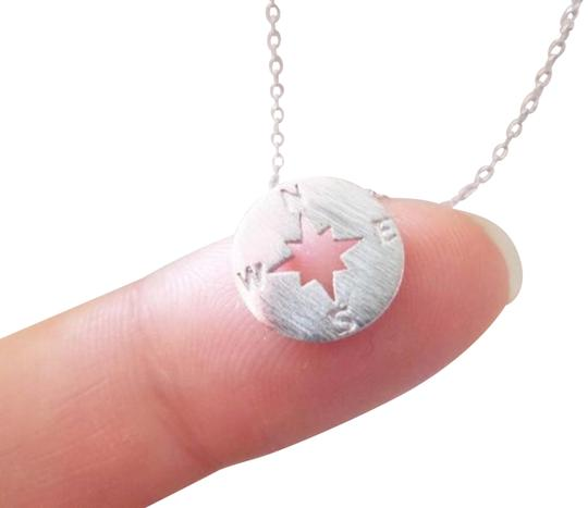 Preload https://img-static.tradesy.com/item/20727124/silver-tiny-circle-disk-compass-compass-in-necklace-0-5-540-540.jpg