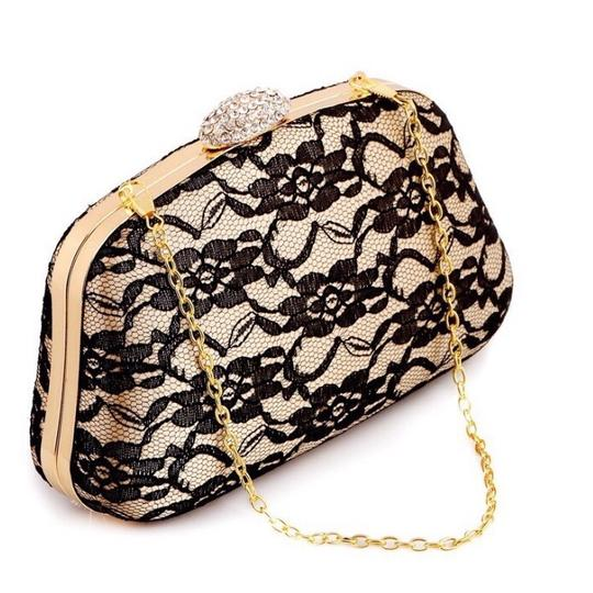 Preload https://img-static.tradesy.com/item/20727252/vintage-jacquard-clutch-0-0-540-540.jpg