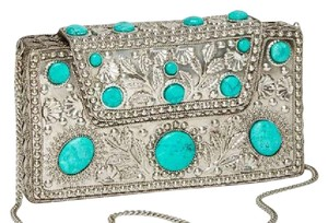 From Xavier silver Clutch