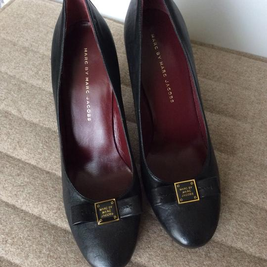 Preload https://img-static.tradesy.com/item/20731292/marc-by-marc-jacobs-black-with-gold-accent-logo-high-heel-pumps-size-us-95-regular-m-b-0-2-540-540.jpg