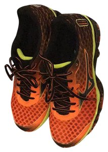 Mizuno orange and black Athletic