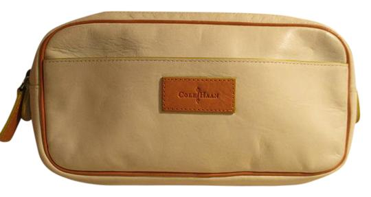 Preload https://img-static.tradesy.com/item/20736426/cole-haan-white-and-tan-leather-clutch-0-1-540-540.jpg
