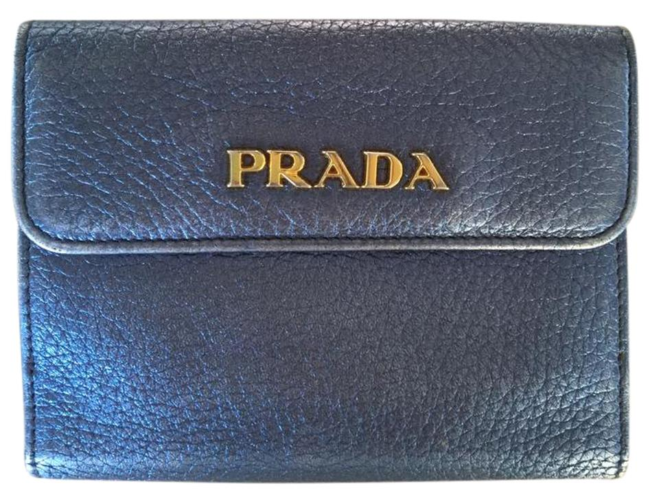 5f0c6e11f69d Prada Prada Triangle Bi-fold Tab Wallet in metallic blue Image 0 ...