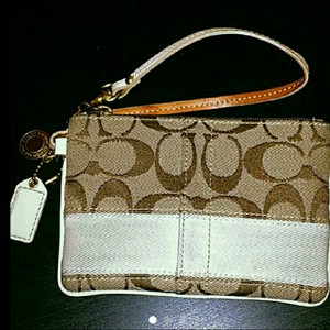 Coach Wristlet in tan and white