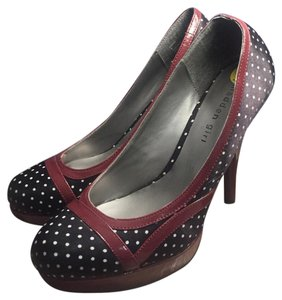 Madden Girl black and white polka dot with cranberry accent trim and heel. Platforms