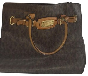 Michael Kors Tote in dark brown with MK all over it