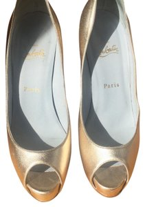Christian Louboutin They are a gold/silver color, depending on the light and what you are wearing. Platforms