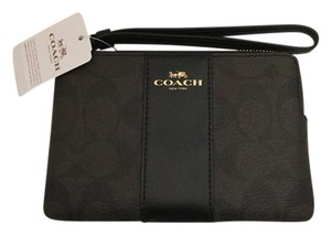 Coach Signature Wristlet in brown and black