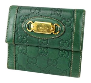 Gucci Gucci Embossed Signature Wallet