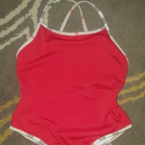 Burberry Girl's swimsuit. Great condition. Normal piling but still in excellent condition.