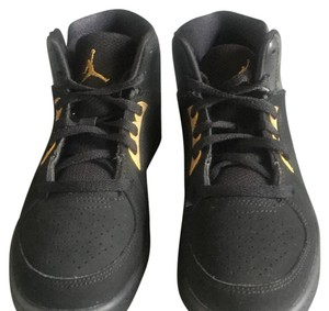 Nike Black w/ a Gold Accent Athletic