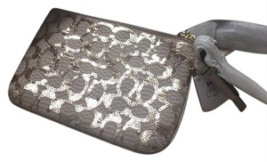 Coach Wristlet in champagne