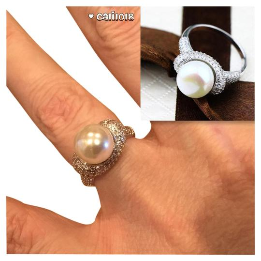 Preload https://img-static.tradesy.com/item/20761272/white-and-silver-new-pearl-sapphire-filled-ring-0-1-540-540.jpg