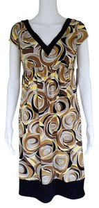 Maggy London short dress Multi-color Slinky Empire Waist Yellow Brown Pull-on on Tradesy