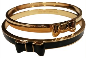 Kate Spade 2 bow bangles one gold one black