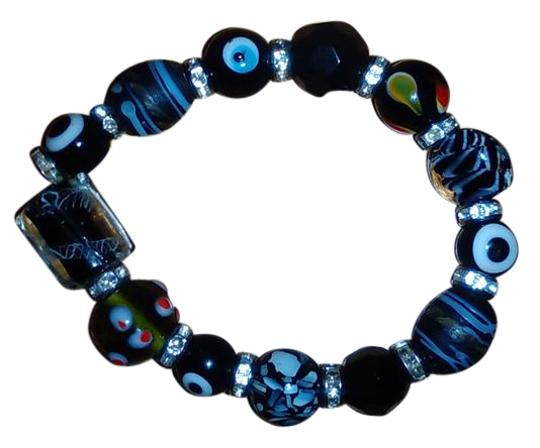 Preload https://img-static.tradesy.com/item/20764858/multi-color-ladies-greek-evil-eye-good-luck-stretch-bracelet-0-1-540-540.jpg