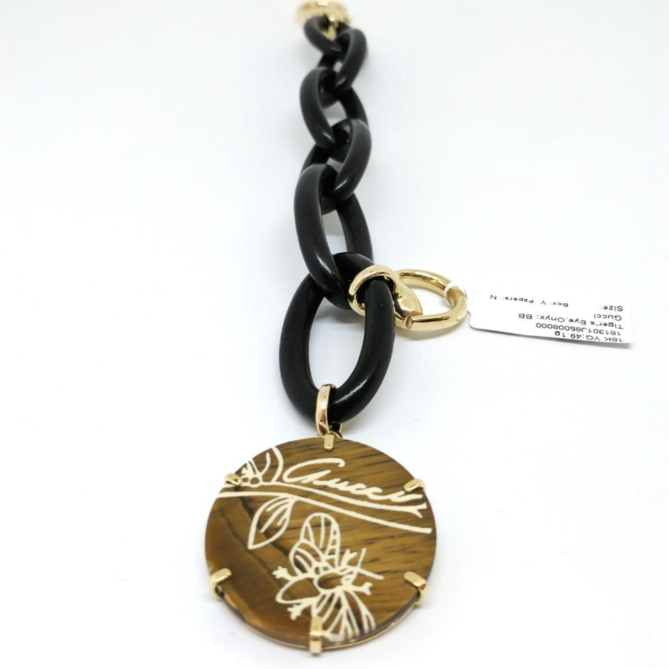 3e79b9b82 Gucci Black Onyx with 18kt Yellow Gold Weighing 49.q Grams Flora ...