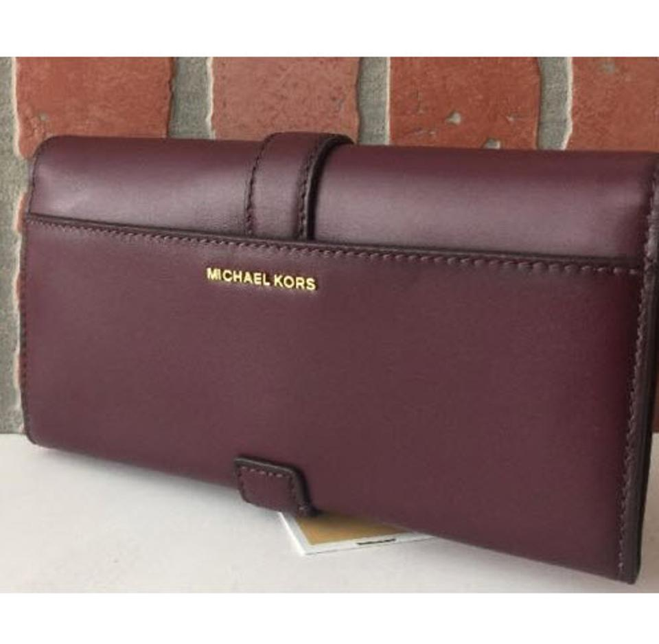 6f829122a798ee Michael Kors MICHAEL KORS QUINCY LARGE CARRYALL SMOOTH LEATHER WALLET IN  PLUM Image 8. 123456789