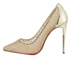 Christian Louboutin Gold Pumps