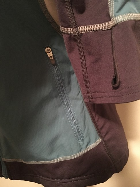 The North Face Front zippered, thumb loop,zippered side pockets, back zippered pouch Image 2