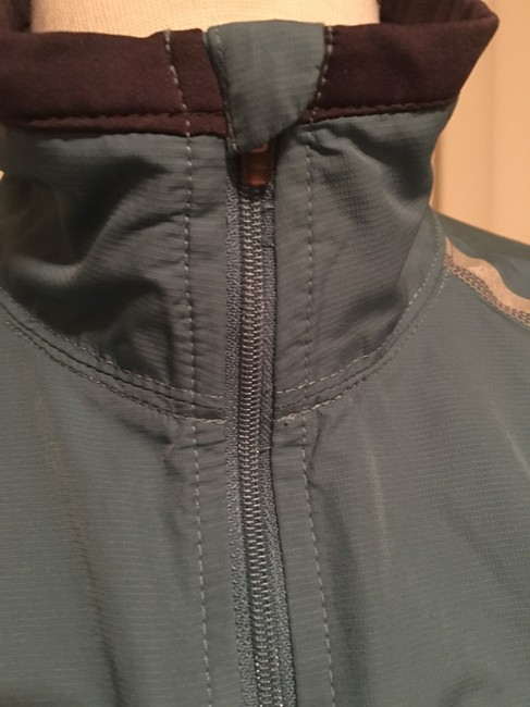 The North Face Front zippered, thumb loop,zippered side pockets, back zippered pouch Image 3