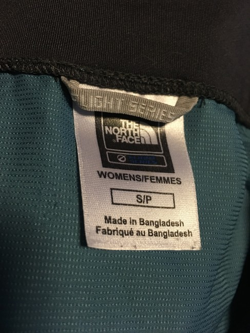 The North Face Front zippered, thumb loop,zippered side pockets, back zippered pouch Image 6
