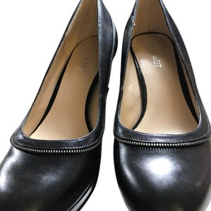 Nine West pumps for the office black with small silver motif on outside of leather along with additional leather strap strap Pumps