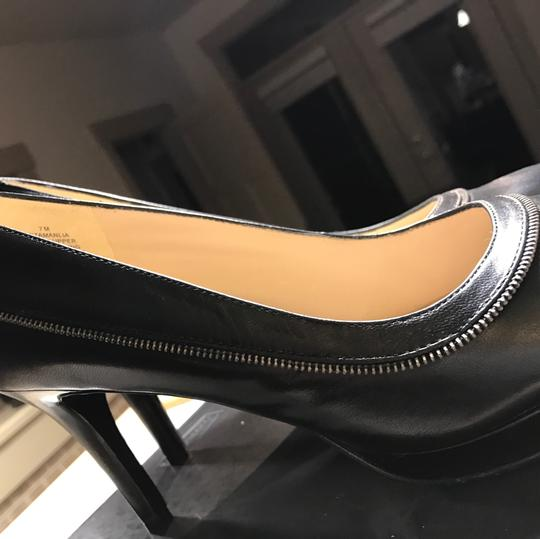Nine West pumps for the office black with small silver motif on outside of leather along with additional leather strap strap Pumps Image 1