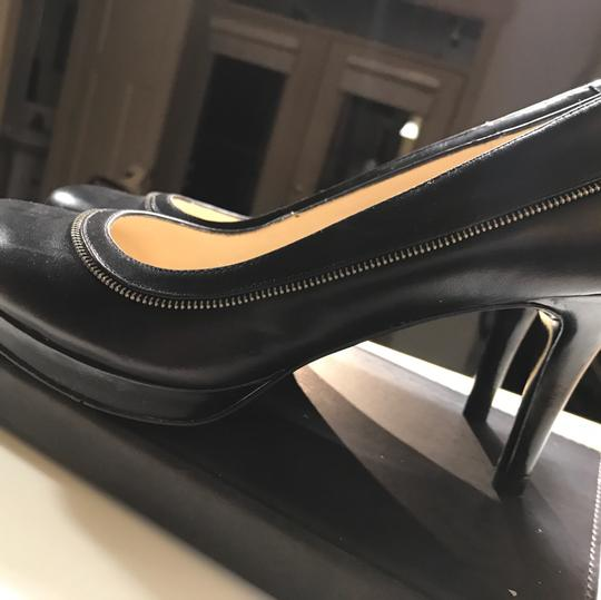 Nine West pumps for the office black with small silver motif on outside of leather along with additional leather strap strap Pumps Image 2