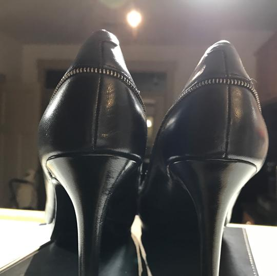 Nine West pumps for the office black with small silver motif on outside of leather along with additional leather strap strap Pumps Image 3