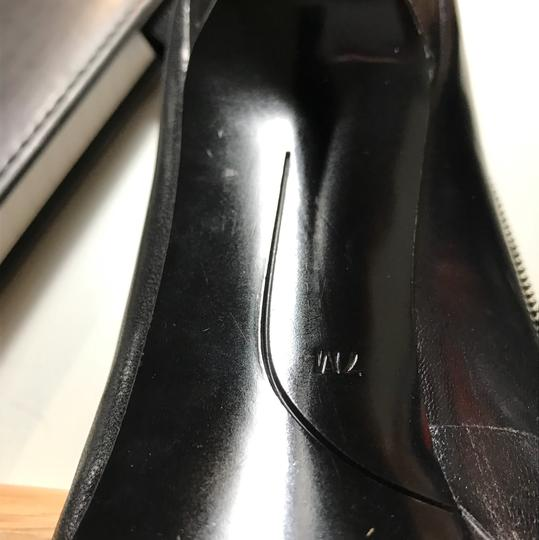Nine West pumps for the office black with small silver motif on outside of leather along with additional leather strap strap Pumps Image 6