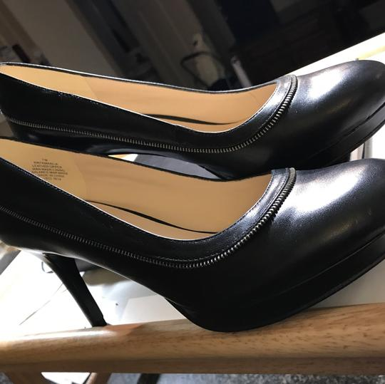 Nine West pumps for the office black with small silver motif on outside of leather along with additional leather strap strap Pumps Image 8