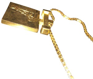 Versace Versace Gold chain w solid Gold bar Medusa pendant