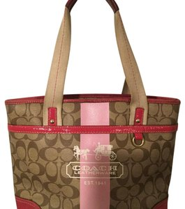 Coach Zippered Top Closure 2 Outside Pockets 3 Interior Pockets Gold Hardware Tote in Brown & Fuchsia