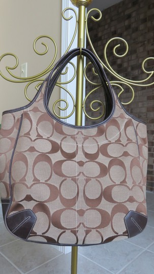 Coach Large Leather Trimmed Signature Fabric Tote in brown Image 1